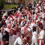accordian players lead the crowd during the Obby Oss May Day festival in Padstow